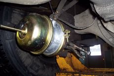 to do this, crawl under truck or trailer and find brake chamber to the  wheel with brakes you want to release